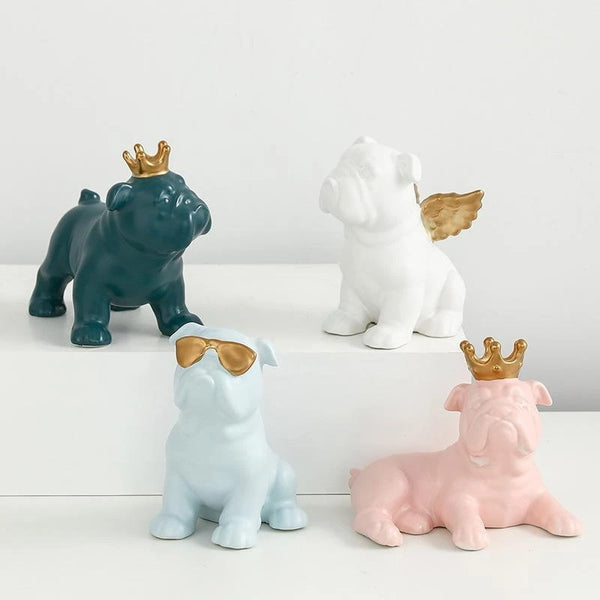 Image of four English Bulldog Statues made of ceramic in four color - white, pink, light blue and teal