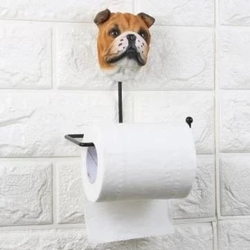 Image of a toilet roll holder in the shape of an english bulldog with arms holding the tissue paper roll