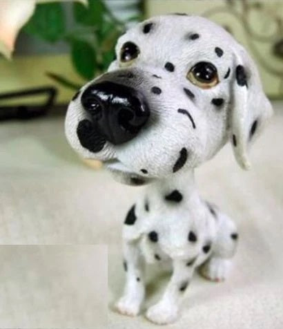 Image of an extra large bobblehead accessory in the shape of a dalmatian, made of resin
