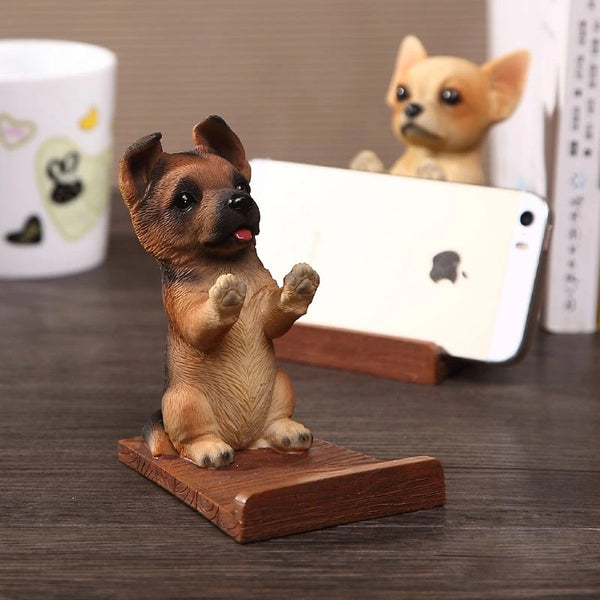 Image of a cell phone holder made of resin and wood in the shape of a german shepherd
