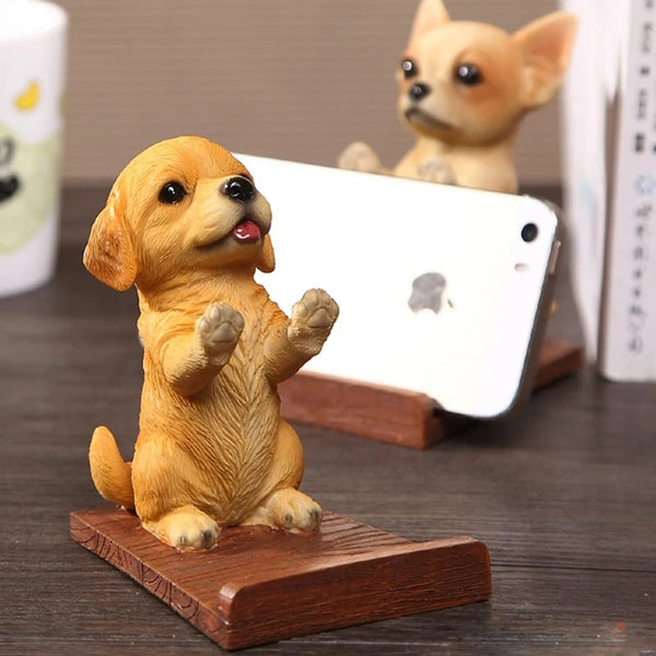 Image of a cell phone holder made of resin and wood in the shape of a golden retriever