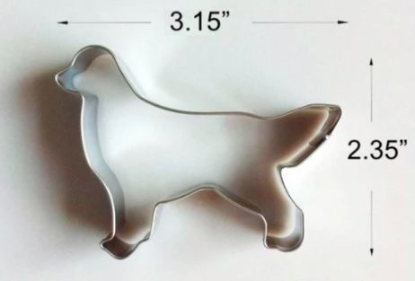 Image of a cookie cutter for baking in the shape of a standing Golden Retriever