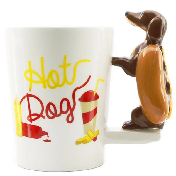 Image of a white coffee cup with a dachshund sitting on the handle, made of ceramic