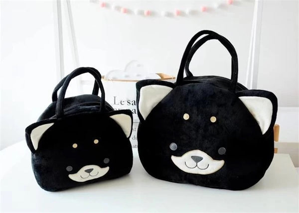 Image of two black color handbags in the shape of husky, made of plush