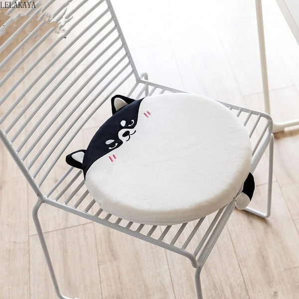 Image of a white and black color stuffed plush floor or chair cushion in the shape of a husky, made of cotton