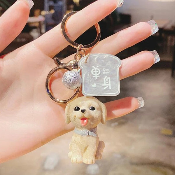 Image of a cute keychain of yellow labrador retriever, made of PVC