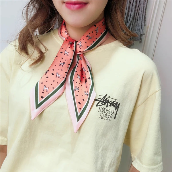 Image of a girl wearing cute Dalmatian Neck Scarf in peach color, made of polyester