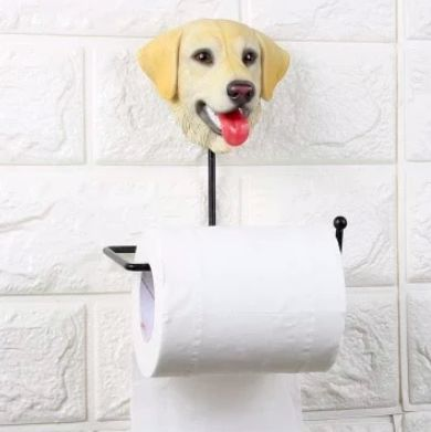 Image of a toilet roll keys napkin holder on a bathroom wall with a cute smiling labrador face design