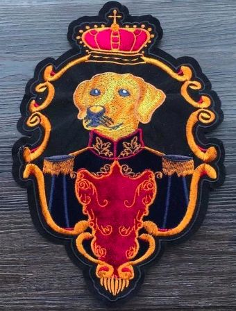 Image of a large sew on patch with a yellow labrador retriever dressed in a formal military suit with a red crown on top