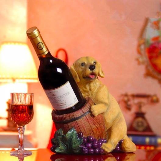 Image of a wine holder in the living room in the shape of a smiling yellow labrador retriever holding the bottle of wine in a brown wooden barrel