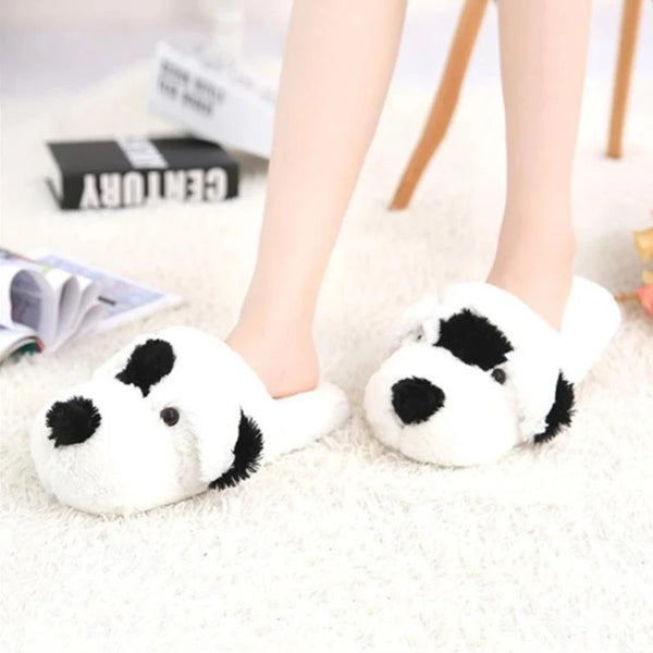 Image of one spot indoor dalmatian slippers in the color black and white made of flock fabric upper, soft plush lining and TPR outsole