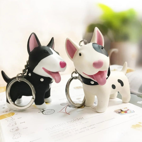 Image of two smiling bull terrier keychains in black and white color with 3D Bull Terrier design, made of PVC