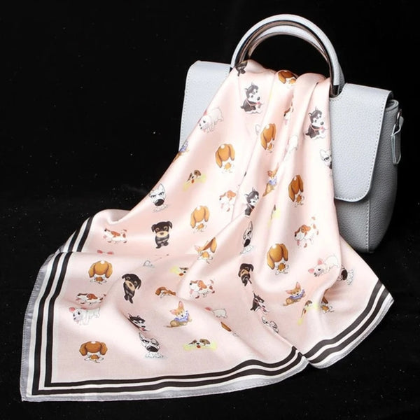 Image of a cute husky Scarf in pink color with a print of several dogs, made of 100% silk