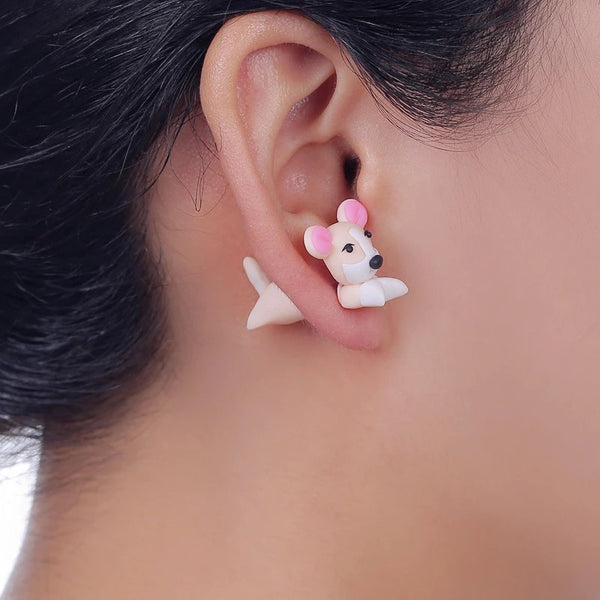 Image of an adorable earring in the shape of a chihuahua wore by a girl, handmade with polymer clay