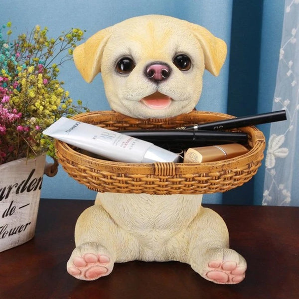 Image of a yellow Labrador Statue made of resin, sitting on a table and holding basket