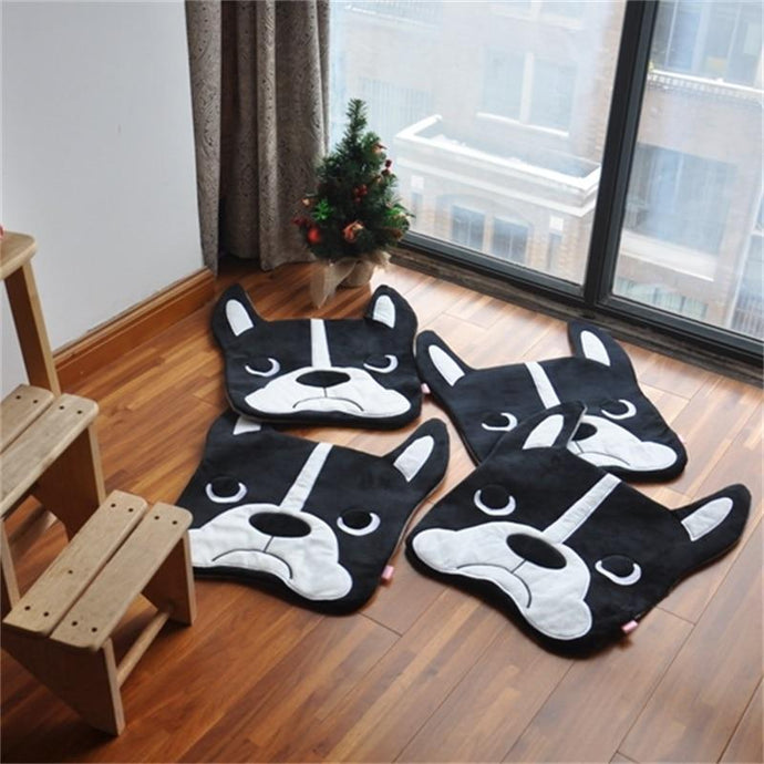 Image of four Boston Terrier floor rugs lying on the floor, shaped like cute Boston Terrier faces