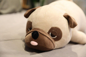Image of a Pug stuffed animal soft plush toy lying on the bed