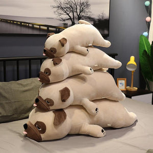 Image of four Pug stuffed animals soft plush toys of diferent sizes lying on the bed