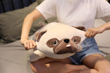 Load image into Gallery viewer, Image of a girl on the bed holding a Pug stuffed animal by his ears