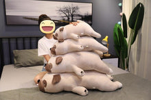 Load image into Gallery viewer, Image of a girl on the bed next to four Pug stuffed animals soft plush toys in different sizes