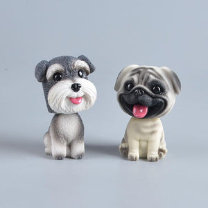 Image of a smiling Schnauzer and Pug bobblehead