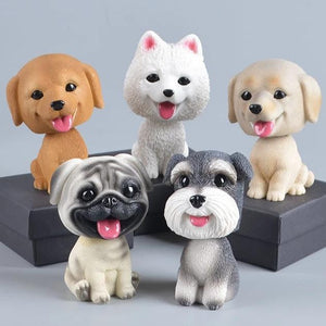 Image of five dog bobbleheads including Golden Retriever, Samoyed, Labrador, Pug, and Schnauzer bobblehead
