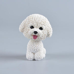 Image of a smiling Bichon Frise bobblehead