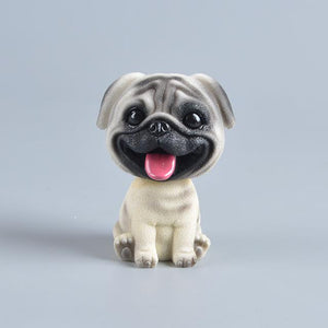 Image of a smiling Pug bobblehead