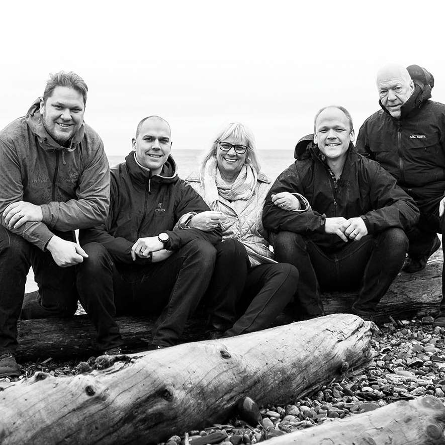 Wasmuth brothers, Andrew, James and Matthew co-founders of PetKind, with their mum and Dad by the beach.