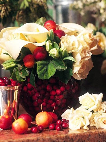 Cranberries submerged in a vase make for a fun and festive holiday arrangement. Make sure to change the water frequently at least once every two days ... & Incorporating Fruits Vegetables and Herbs In Your Flower Arrangement