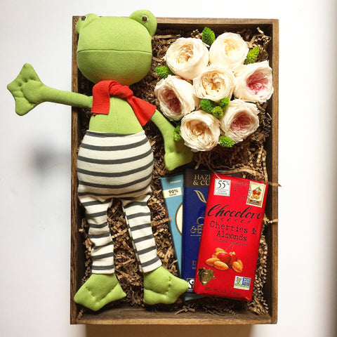 Frog with flowers and chocolate