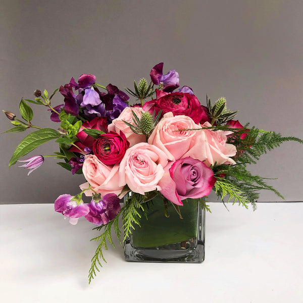 Alaric Flowers - flower delivery nyc same day - orchids nyc - sweet peas - florist 10019 - Flowers used for this arrangement: roses, sweet peas, clematis, ranunculus and variety of greens.
