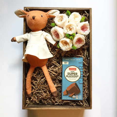 Fawn with flowers and chocolate