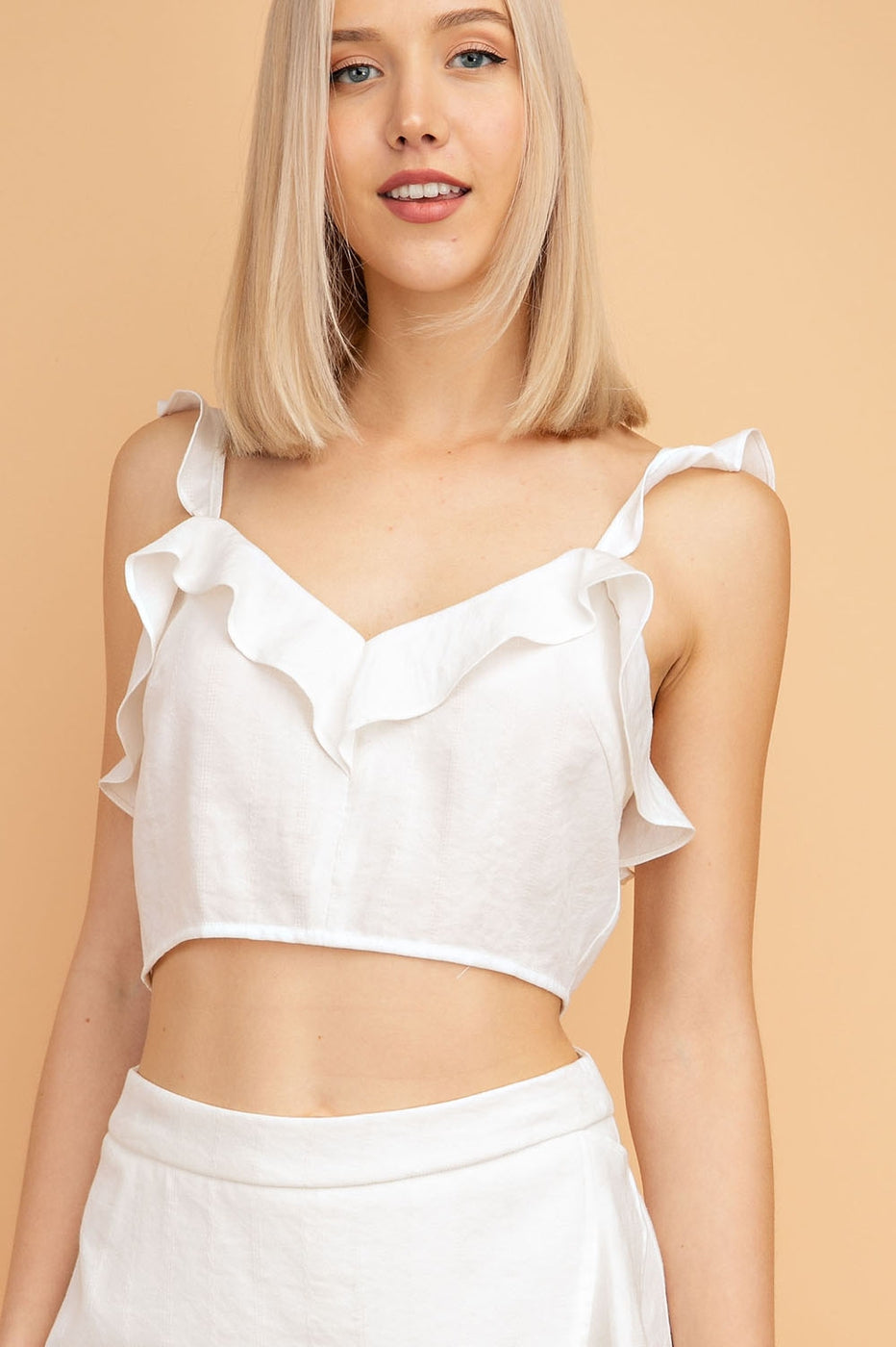 Sleeveless Crop Top With Back Zipper and Ruffle Detailing In Off-White Siin Bees