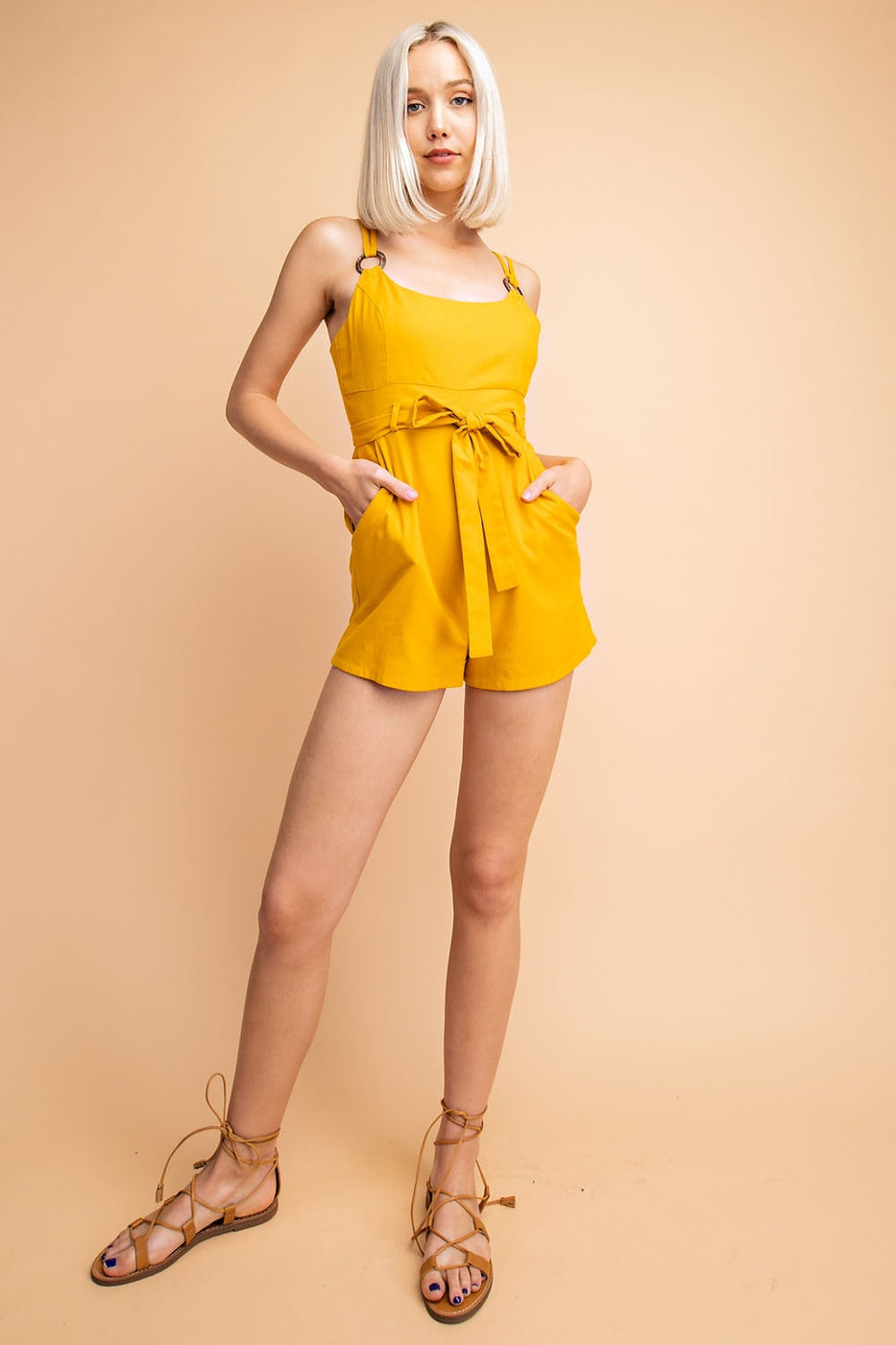 Linen Romper With Waist Tie And Straps Attached To Wooden Ring Siin Bees