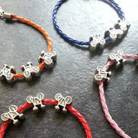 Bracelet with Three Bike Charms - Great Gift for a Bike Rider or Bicycle Fiend - Velo Tour Theme - Awesome Bike Gifts - Bike Essentials Accessories And T-shirts