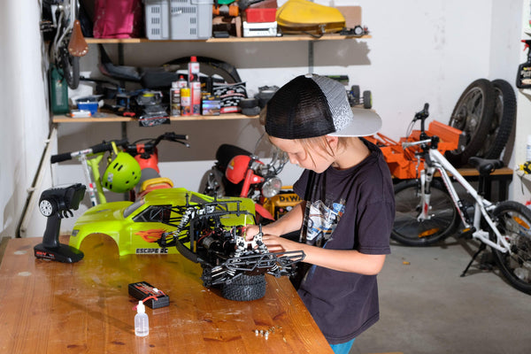 7 year old wrenching on his Escape RC car