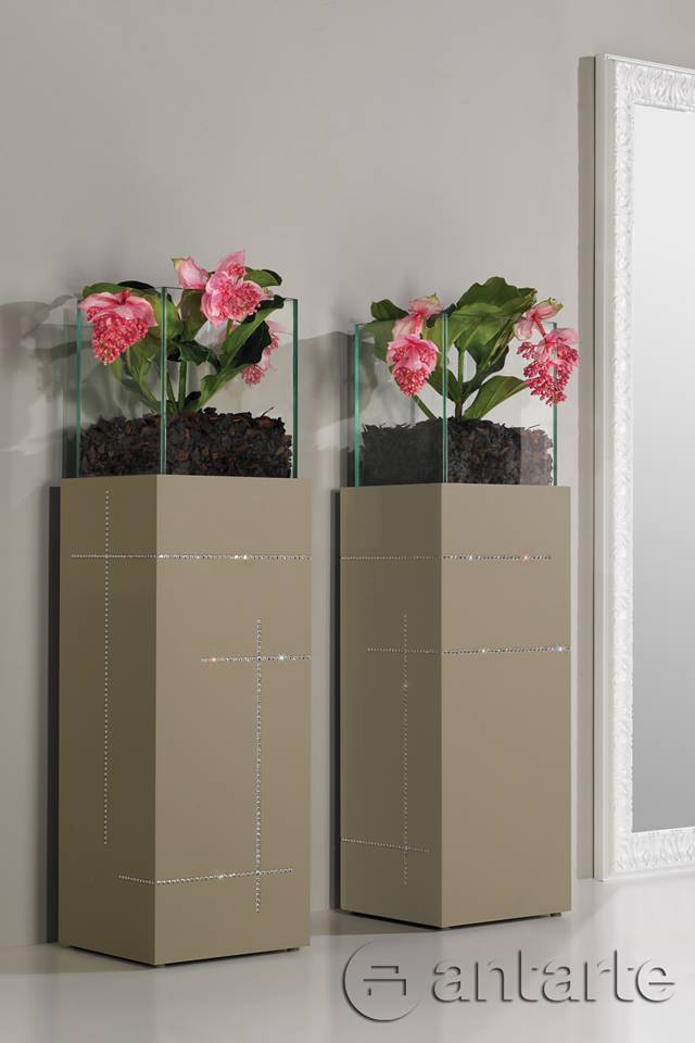 Designer flower pots and vases. Lacquered wood base and tempered glass top.