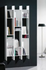 Wall mounted shelving options in white wood.