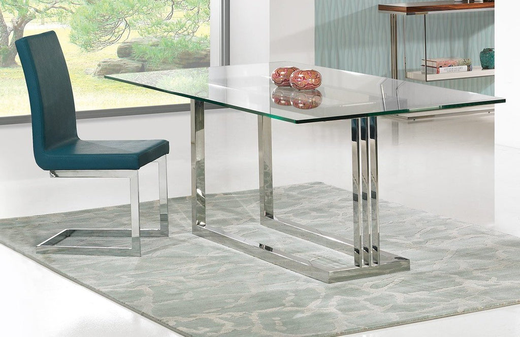 Londres glass top dining table with designer steel leg. Londres Dining chair in eco-leather.