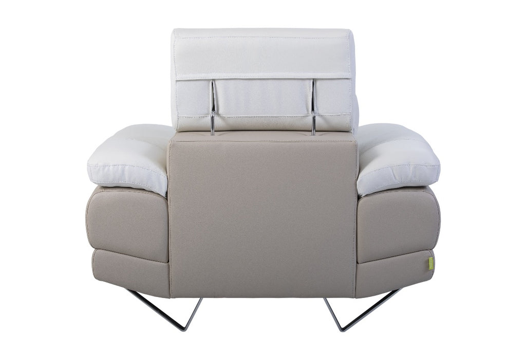 Dennis sofa armchair with adjustable headrests and steel legs.