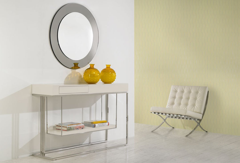 The Londres Console with 1 drawer and hanging shelf display, stainless steel leg and finished in a Cream lacquer.