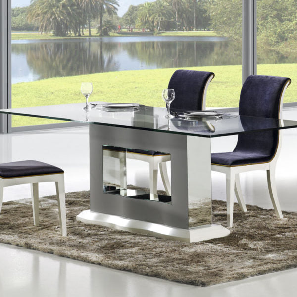 Viena glass dining table with luxury curved Viena dining chairs.