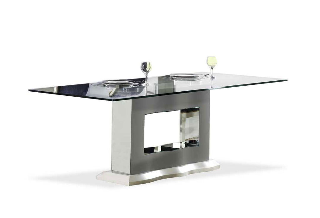 Luxury Viena glass top dining table, mirror leg and handcrafted wave design.