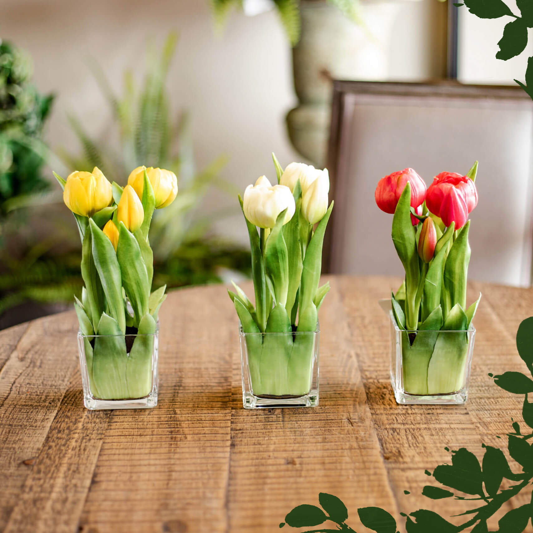 Realistic faux Tulips in glass containers to decorate your  home for spring or Easter.