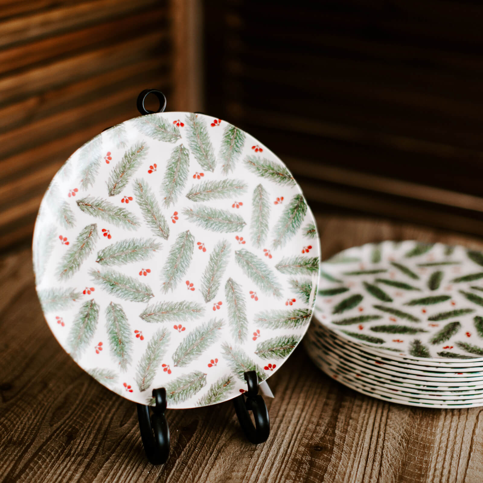 10 inch botanical plate with pine branches and berries pattern for holiday table