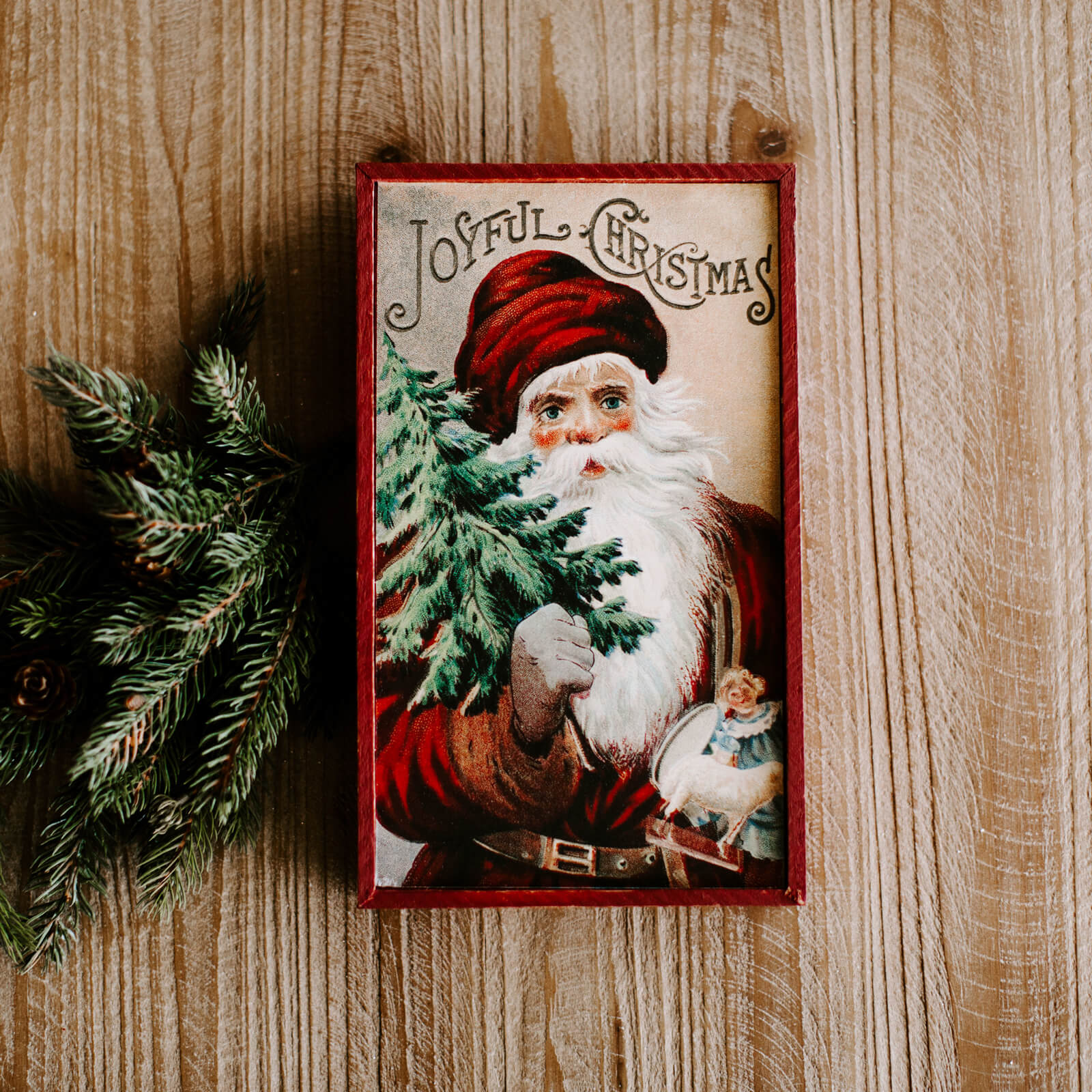 A rectangular vintage looking Santa wall sign that reads Joyful Christmas