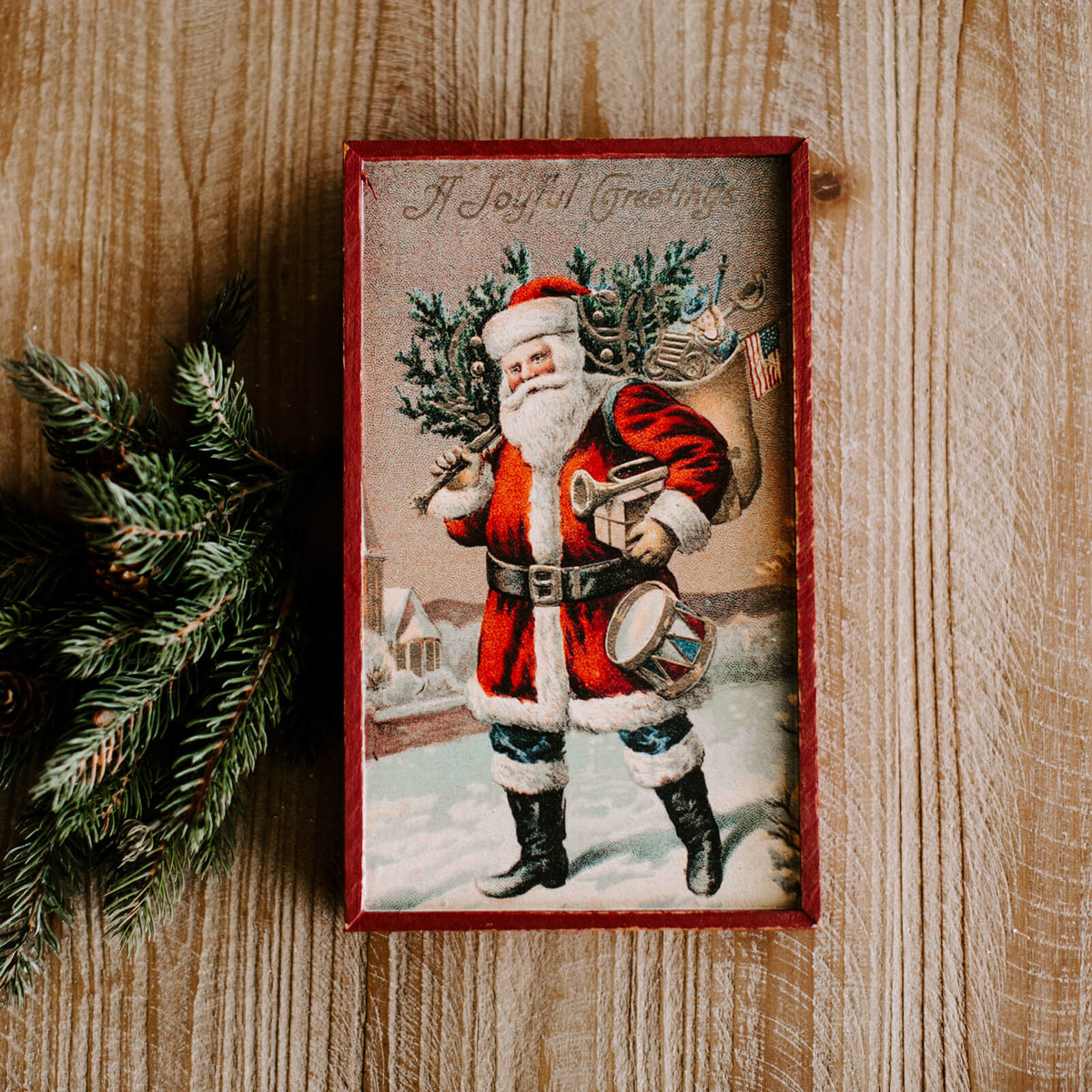 "A rectangular vintage looking Santa wall sign that reads ""A Joyful Greetings"""