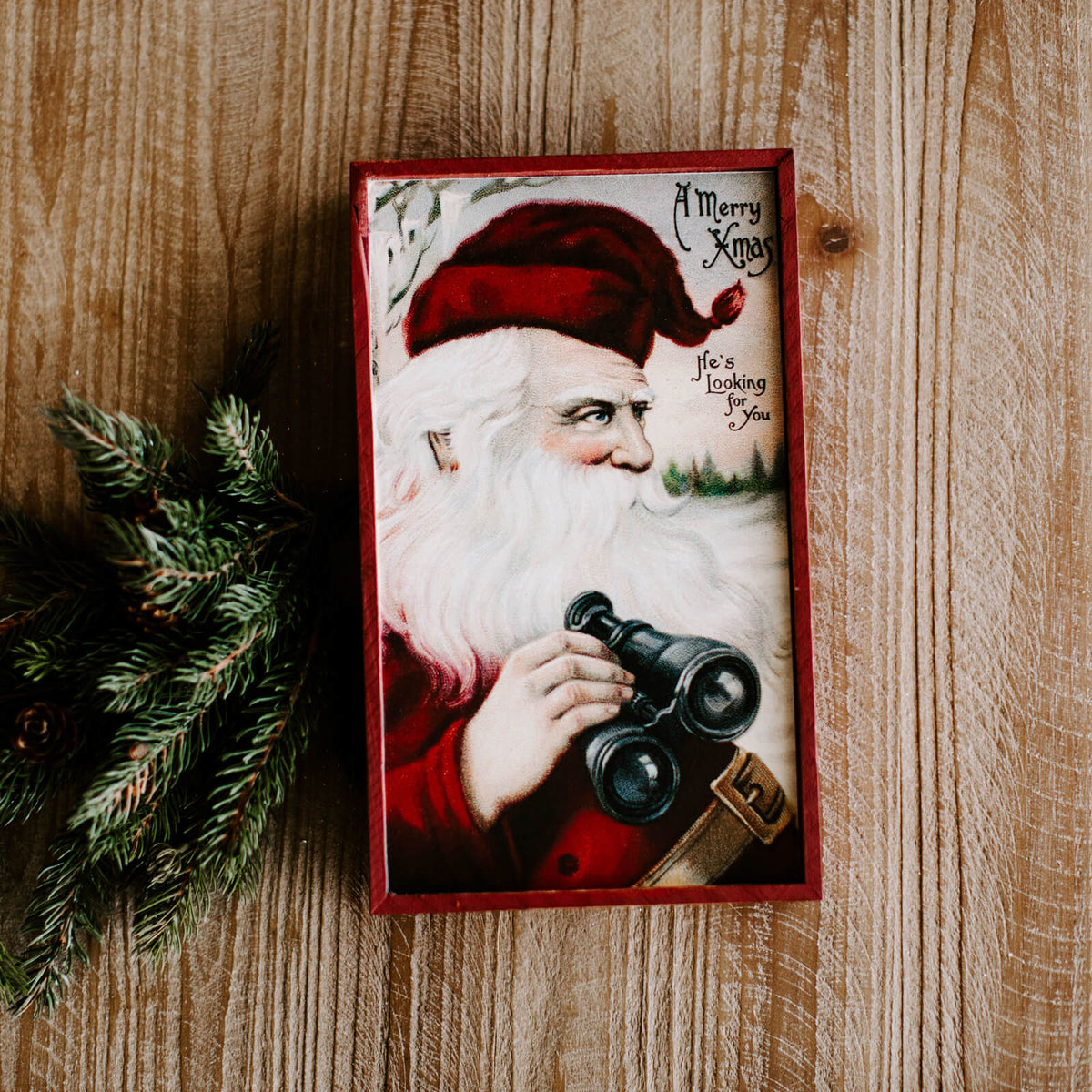 "A rectangular vintage looking Santa wall sign that reads ""A Merry Xmas"""