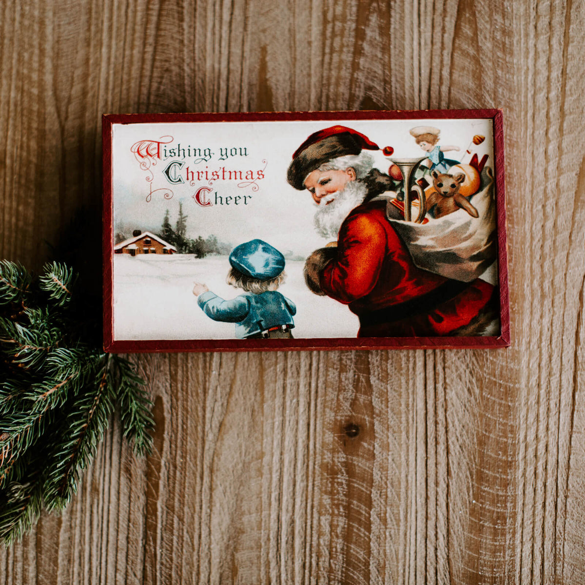 "A rectangular vintage looking Santa wall sign that reads ""Wishing you Christmas Cheer"""